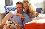 Sunset Magazine Home and Sunbrella advertising at Seabrook, WA of couple enjoying morning coffee and newspaper on Sunbrella furniture