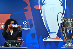 NYON, SWITZERLAND - Monday, December 17, 2018: Lyon player Laura Georges holds up Olympique Lyon after making the draw during the UEFA Champions League 2018/19 Round of 16 draw at the UEFA House of European Football. (Handout by UEFA)