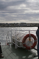 Ferry leaving Inis Oirr the Aran Islands in Galway Ireland