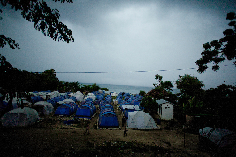 A flooding camp of people displaced by the January earthquake.