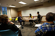 Joao Ribeiro, left, Lile Shi and Ming Tian Chen, in Professor Mike Geringer's business class role play during an in-class assignment on October 30, 2013. Photo by Stephen Reiss