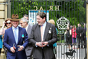 Racegoers enter the racecourse via the Sir Henry Cecil Gates prior to the third day of the Dante Festival at York Racecourse, York, United Kingdom on 17 May 2019.