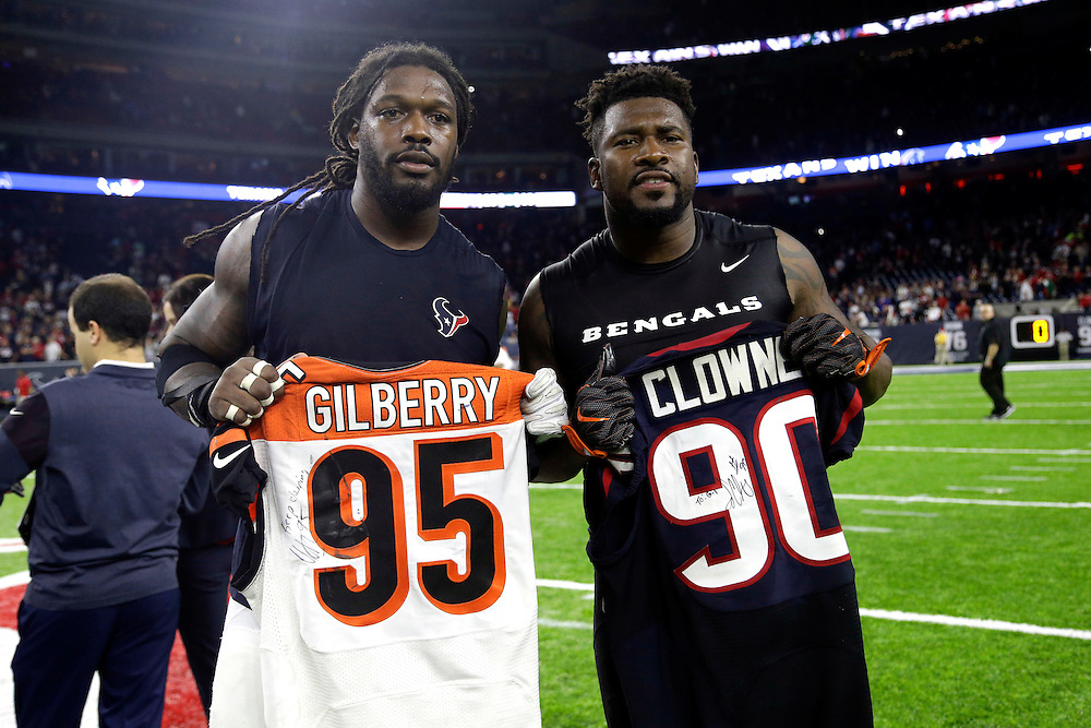 Houston Texans defensive end Jadeveon Clowney, left, and Wallace Gilberry exchange jerseys after an NFL football game Saturday, Dec. 24, 2016, in Houston. The Texans won 12-10. (AP Photo/Sam Craft)