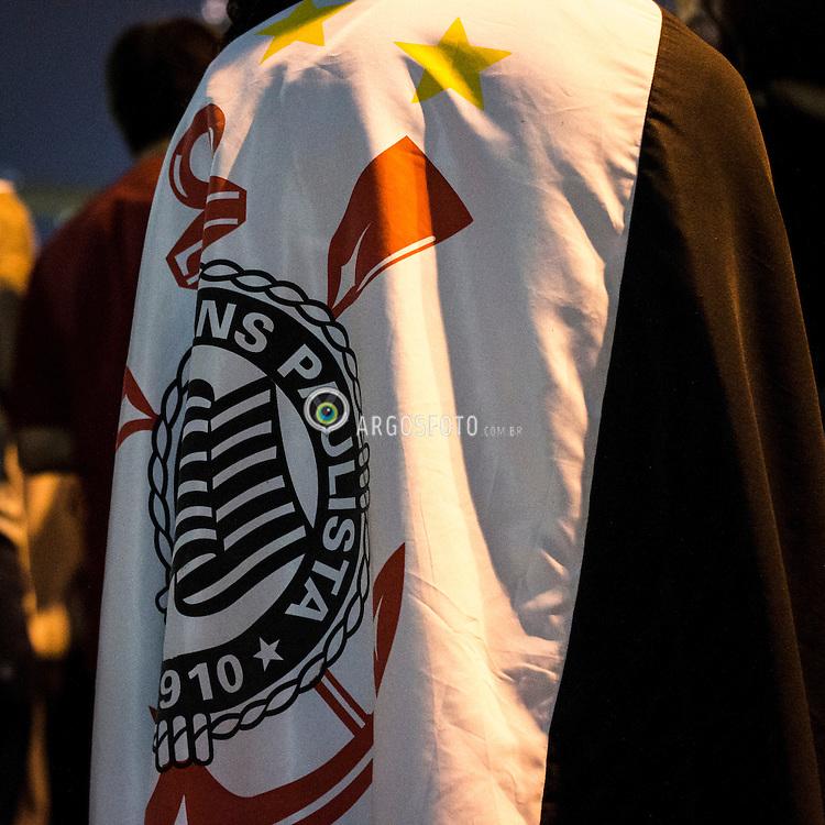 Torcedor do corinthians com bandeira nas costas em frente ao estadio Paulo Machado de Carvalho (Pacaembu) // Football fan with the Corinthians flag at the back, Sao Paulo, Brazil - 2013.