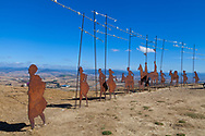 Cast iron pigrim silhouette statues on the ridge of Alto de Perdon