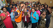 """Central Terminal staff celebrate being the winners of the """"Best Terminal Attendance STAAR Testing Week"""" contest, April 11, 2014."""
