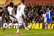 Emmanuel Adebayor of Tottenham Hotspur (left) scores his second goal of the game to make it 3-2  on the night during the UEFA Europa League match at White Hart Lane, London<br /> Picture by David Horn/Focus Images Ltd +44 7545 970036<br /> 27/02/2014