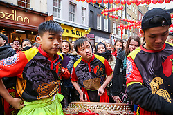© Licensed to London News Pictures. 25/01/2020. London, UK. Lion dancers and drummers in London's China Town as Chinese and non-Chinese community celebrates Chinese New Year, the Year of the Rat. Photo credit: Dinendra Haria/LNP