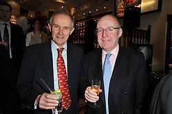 Left to right,  JONATHAN POWELL co writer of the book and racing commentator CORNELIUS LYCETTE at a party to celebrate the paperback publication of Lucky Break by leading trainer Paul Nicholls held at Thomas Pink, 85 Jermyn Street, London on 23rd February 2011.