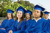 Graduates listening to ceremony outside