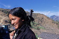 "Kusapani, 03 March 2005... A Maoist fighter. ""No one is forced to join the Red Army, it is their free will to become a soldier. Wegive them a six months training"" a Maoist spokesman says. ---------- Speaking to a Police officer in Surket, he says: ""Their (Maoist Army) strong tactic is surprise. We never know when they could attack us. When someone comes towards us, we never know whether they are about to say Namaste or throw a hand grenade at us."""