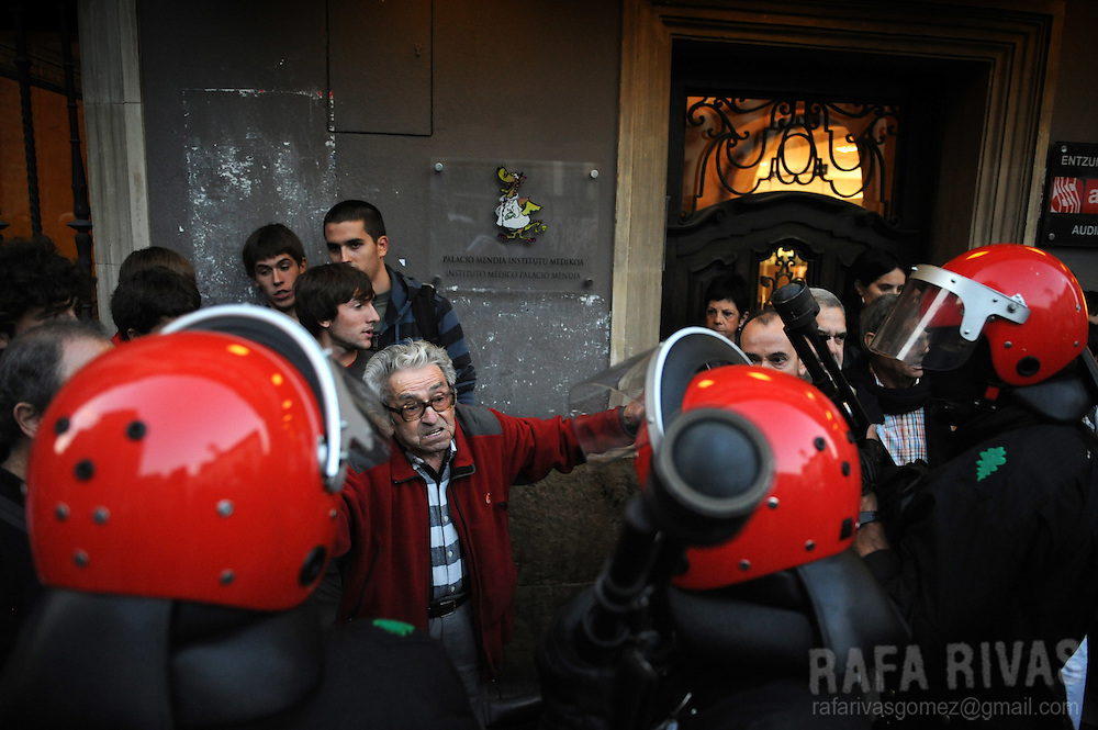 A man protests in front of Basque regional police during a festive gathering, on September 25, 2009, in the northern Spanish Basque city of Mondragon. Some participants showed posters supporting imprisoned members of Basque separatist armed group ETA. PHOTO RAFA RIVAS
