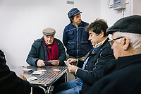 MONTECORICE, ITALY - 14 FEBRUARY 2018: Men play cards at Bar San Biagio in Montecorice, the town that will host a rally by Franco Alfieri (Democratic Party, PD, Partito Democratico), a candidate running for the Chamber of Deptuies in the 2018 Italian General Elections, in Montecorice, Italy, on February 14th 2018.<br /> <br /> Montecorice is part of the electoral college of Agropoli, in the Campania region (southern Italy) in which Franco Alfieri (Democratic Party, PD, Partito Democratico), politically active for the past 30 years, is running agains the 28-years old Alessia d'Alessandro (Five Stars Movement, M5S, Movimento 5 Stelle).<br /> <br /> The 2018 Italian general election is due to be held on 4 March 2018 after the Italian Parliament was dissolved by President Sergio Mattarella on 28 December 2017.<br /> Voters will elect the 630 members of the Chamber of Deputies and the 315 elective members of the Senate of the Republic for the 18th legislature of the Republic of Italy, since 1948.Santa<br /> <br /> The 2018 Italian general election is due to be held on 4 March 2018 after the Italian Parliament was dissolved by President Sergio Mattarella on 28 December 2017.<br /> Voters will elect the 630 members of the Chamber of Deputies and the 315 elective members of the Senate of the Republic for the 18th legislature of the Republic of Italy, since 1948.