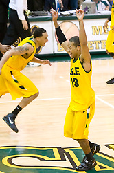 January 30, 2010; San Francisco, CA, USA;  San Francisco Dons guard Rashad Green (13) celebrates after the game against the Gonzaga Bulldogs at the War Memorial Gym.  San Francisco defeated Gonzaga 81-77 in overtime.