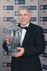 CARDIFF, WALES - Wednesday, November 11, 2009: Sky Sports' Bryn Law with the Welsh Player of the Year Trophy during the Football Association of Wales Player of the Year Awards hosted by Brains SA at the Cardiff City Stadium. (Pic by David Rawcliffe/Propaganda)