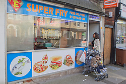 Mother with twins in buggy at chip shop. (This photo has extra clearance covering Homelessness, Mental Health Issues, Bullying, Education and Exclusion, as well as the usual clearance for Fostering & Adoption and general Social Services contexts,)