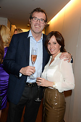 ANDREW MORTON and his wife CAROLYN at a reception to launch the range of Dr Lancer beauty products held at The Penthouse, Harrods, Knightsbridge, London on 16th September 2013.
