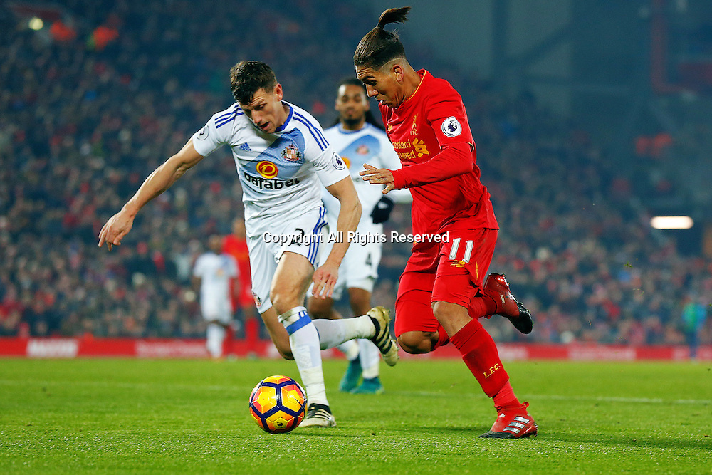 26.11.2016. Anfield, Liverpool, England. Premier League Football. Liverpool versus Sunderland. Roberto Firmino of Liverpool  runs with the ball covered by Billy Jones of Sunderland