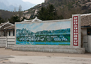 KUMGANG<br /> THE NORTH KOREAN GHOST TOWN<br /> <br /> The first town USA will find on his way to invade NK will be this ghost town where HUnday lost 1 billion USD..<br /> <br /> The Mount Kumgang tourist complex in North Korea, near the DMZ, was built in 1998 by the South Korean giant company Hyundai. The chaebol paid a fee of $1 billion to the North Korean government for 50 years of exclusivity. The cost of the 500-square kilometer complex was $400 million, including hotels, a spa, a fire station, a tourism office, a golf course, a supermarket, a clinic, tours in the mountain... Kumgang resort attracted nearly 2 millions south korean tourists from1998 to 2008.<br /> In July 2008 a South Korean tourist, Miss Park Wang-ja, was shot dead there and South Korea decided to stop all the tours in North Korea. The North Korean government said the tourist entered the military zone, and ignored the warnings from the north korean soldiers.<br /> So in retaliation, North Korea decided to seize the whole tourist complex. This decision was a real drama. Not for the touristic industry only, but for the separated families from the south and the north: Kumgang was also the place where hundreds of North and South Korean relatives were meeting each other for the first time in decades.<br /> For those reasons, since 2008, Mount Kumgang complex has became a ghost town. Only very few western tourists could visit the area.<br /> <br /> Photo shows:  A big and dull billboard shows the complex has it should have been if the joint venture deal would have go on...North Korea tries to find new investors but the task is tough.<br /> &copy;Eric Lafforgue/Exclusivepix Media
