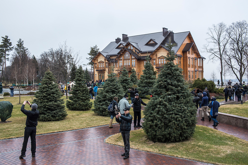 KIEV, UKRAINE - FEBRUARY 22: People wander around President Viktor Yanukovych's Mezhyhirya estate, which was abandoned by security, on February 22, 2014 in Kiev, Ukraine. After a chaotic and violent week, protesters took control of Kiev as President Viktor Yanukovych fled the city amid calls for his immediate resignation. (Photo by Brendan Hoffman/Getty Images) *** Local Caption ***