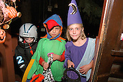 Halloween trick & treaters age 9  looking a little somber.  St Paul Minnesota USA