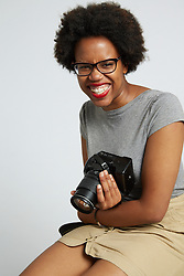 Portrait of Female Photographer Holding Camera
