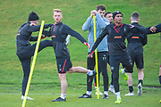 Oliver Bozanic (#7) of Heart of Midlothian and Demetri Mitchell (#11)  of Heart of Midlothian stretch off during training, ahead of the visit of Rangers in the Scottish Premiership on 1st December 2018, at Oriam Sports Performance Centre, Riccarton, Scotland on 30 November 2018.