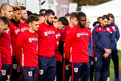 The squad look on as Representatives of Bristol City take part in a ceremony to plant tree's in memory of the 7 Bristol City player's who lost their lives serving during WW1 - Rogan/JMP - 09/11/2018 - FOOTBALL - Failand Training Ground - Bristol, England.