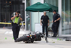 "A police officer photographs a motorcycle after a female stunt driver working on the movie ""Deadpool 2"" died after a crash on set, in Vancouver, BC, Canada, on Monday August 14, 2017. Vancouver police say the driver was on a motorcycle when the crash occurred on the movie set on Monday morning. Photo by Darryl Dyck/CP/ABACAPRESS.COM"