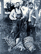 "Alexander ""Sasha"" Siemel (right) with two jaguars and a puma killed with a spear (zagaya)"
