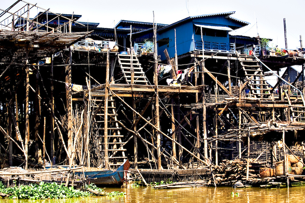 Tonle Sap, near Khampon Khleang : fishing village on stilts.  Wooden ladders separate two to three levels of the houses.  A quirky version of a high rise dwelling.