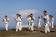 Karate lesson taking place at Batubelig beach, Canggu.
