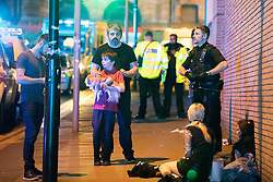 © Licensed to London News Pictures . Manchester, UK.  FILE PICTURE DATED 22/05/2017 of ANDREW ROUSSOS (with beard) with his son XANDER (carrying dog) outside the Manchester Arena following a bomb attack that killed 22 . Mr Roussos' daughter, Saffie Roussos , was the youngest of those killed in the attack and who would have turned nine today (4th July 2017) . Mr Roussos has spoken publicly about the impact of the Manchester Arena terrorist attack which killed his daughter, in an interview for the BBC's Victoria Derbyshire . Photo credit : Joel Goodman/LNP