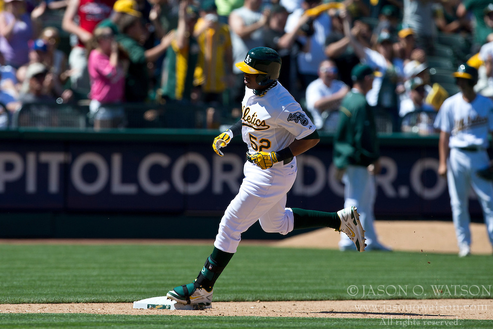 OAKLAND, CA - MAY 19: Yoenis Cespedes #52 of the Oakland Athletics rounds the bases after hitting a go-ahead home run against the Kansas City Royals during the eighth inning at O.co Coliseum on May 19, 2013 in Oakland, California. The Oakland Athletics defeated the Kansas City Royals 4-3. (Photo by Jason O. Watson/Getty Images) *** Local Caption *** Yoenis Cespedes