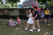 As heatwave temperatures climb to record levels - the hottest day of the year so far - Londoners and visitrs stick to the shade in the City of London (the capital's financial district aka the Square Mile), on 25th July 2019, in London, England.