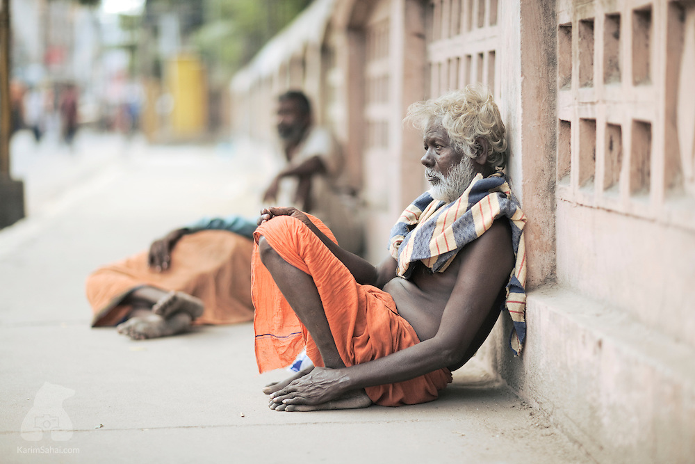 Beggars sitting outside the entrance of the Shri Minakshi temple.