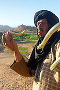 Snake charmer performs for tourists outside the Ait BenHaddou ksar, Ouarzazate, Morocco Morocco, 2014-04-24. <br />