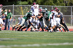 08 September 2012:  Aaron Hahn tries the middle for short yardage but gets stood up by the Titan defense during an NCAA division 3 football game between the Alma Scots and the Illinois Wesleyan Titans which the Titans won 53 - 7 in Tucci Stadium on Wilder Field, Bloomington IL