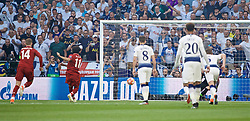 MADRID, SPAIN - SATURDAY, JUNE 1, 2019: Liverpool's Mohamed Salah scores the first goal from a penalty kick during the UEFA Champions League Final match between Tottenham Hotspur FC and Liverpool FC at the Estadio Metropolitano. (Pic by David Rawcliffe/Propaganda)