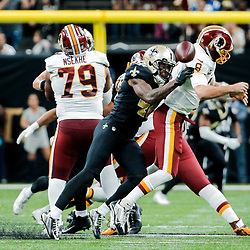 Nov 19, 2017; New Orleans, LA, USA; New Orleans Saints safety Vonn Bell (48) sacks and forces a fumble by Washington Redskins quarterback Kirk Cousins (8) to end of the fourth quarter of a game at the Mercedes-Benz Superdome. The Saints defeated the Redskins 34-31 in overtime. Mandatory Credit: Derick E. Hingle-USA TODAY Sports