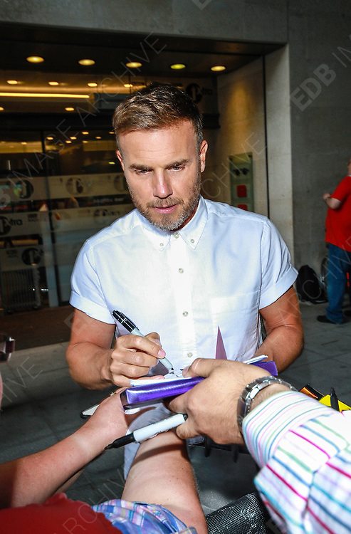 29.AUGUST.2013. LONDON<br /> <br /> GARY BARLOW AND LOUIS WALSH ATTEND THE BBC RADIO ONE STUDIOS, LONDON<br /> <br /> BYLINE: EDBIMAGEARCHIVE.CO.UK<br /> <br /> *THIS IMAGE IS STRICTLY FOR UK NEWSPAPERS AND MAGAZINES ONLY*<br /> *FOR WORLD WIDE SALES AND WEB USE PLEASE CONTACT EDBIMAGEARCHIVE - 0208 954 5968*