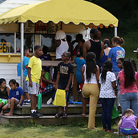 People lined up at the concession stand at Veteran's park Saturday at the back to school event