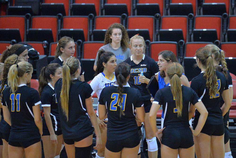 August 26, 2016; Las Vegas, Nev.; UCSB head coach Nicole Lantagne Welch gives her team instructions in a timeout during a match between the UNLV Lady Rebels and UC Santa Barbara Gauchos. UNLV defeated UCSB 3-0.