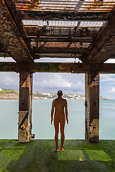 "@Licensed to London News Pictures 31/08/2017 Folkestone, Kent. 'Another Time XVIII 2013"" sculpture is situated at the Loading Bay on the Harbour Arm during Folkestone Triennial 2017. The sculptor Antony Gormley has erected two more statues one in Margate and the other in Folkestone Harbour Arm. Folkestone Triennial is the flagship project of the Creative Foundation, an independant arts charity enabling the regeneration of the seaside town of Folkestone in Kent through creative activity. Photo credit: Manu Palomeque/LNP"