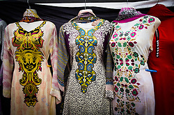 © Licensed to London News Pictures. <br /> 06/06/2014. <br /> <br /> Middlesbrough, England<br /> <br /> Dresses hang in a stall at the start of the 24th Middlesbrough Mela event.<br /> <br /> The Middlesbrough Mela has become the largest and most spectacular multicultural festival in the North East.<br /> <br /> Photo credit : Ian Forsyth/LNP