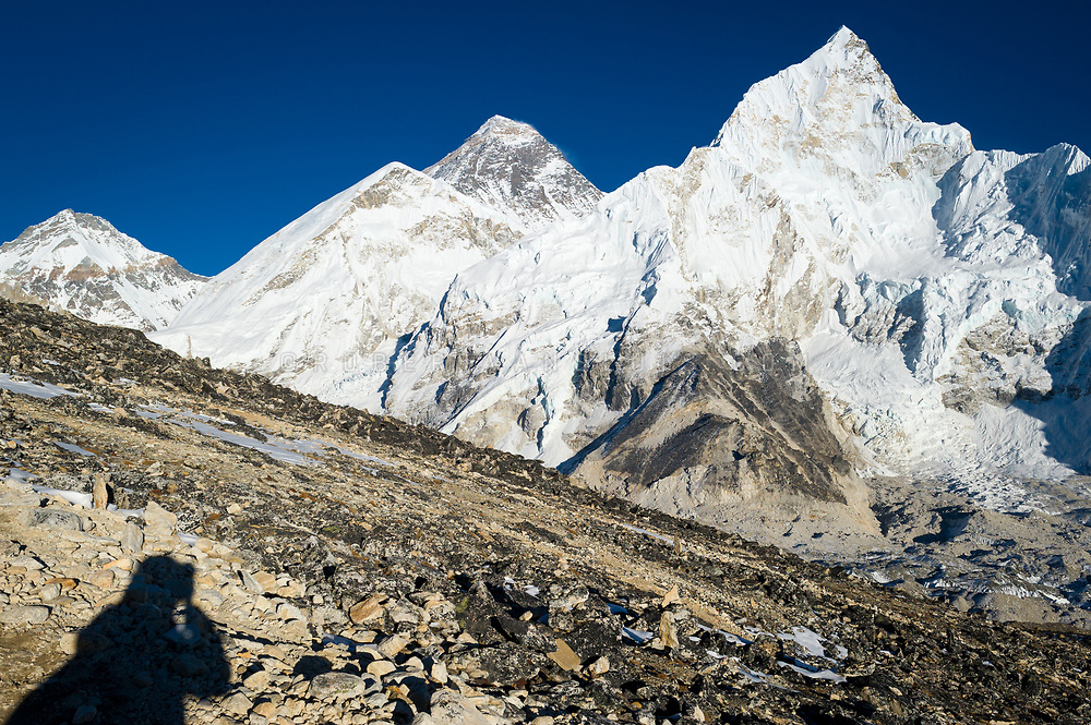 A photographer takes a photo of Nuptse (right) and Mount Everest (middle) from Kala Pattar. Photo © robertvansluis.com