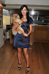 ALEX MEYERS and her dog Ribbon at the 10th anniversary of George in association with The Dog's Trust held at George, 87-88 Mount Street, Mayfair, London on 13th September 2011.