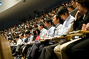 """******FOR MAGAZINE*******.Employees listen to Carlos Ghosn, president and CEO of Nissan Motor Co., during a """"town hall"""" meeting at the automaker's headquarters in Yokohama, Japan on Monday 19 Oct.  2009. .Photographer: Robert Gilhooly/Bloomberg News"""