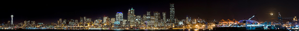 Panoramic view of a Winter lunar eclipse over the city of Seattle in the early evening hours.