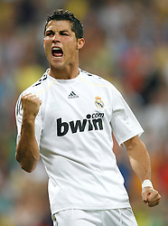 Real Madrid's Cristiano Ronaldo celebrates during a friendly match, July 28, 2009.